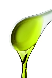 Olive oil pour from spoon